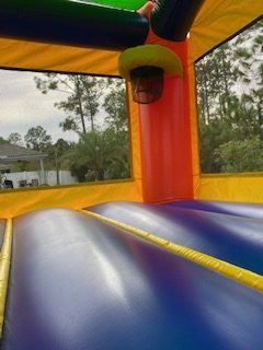 castle combo bounce house and slides with pool